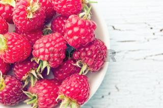 red raspberries in bowl