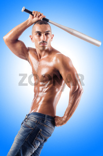 Muscular man with baseball bat on white