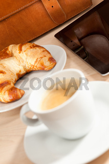 Breakfast with coffee, croissant and Tablet PC