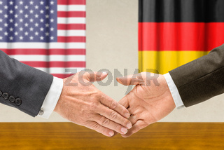 Representatives of the USA and Germany shake hands