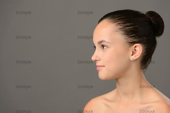 Teenage girl skin care cosmetics looking away