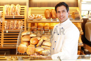 Shopkeeper with basket of bread