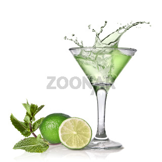 Green alcohol cocktail with splash, lime and mint isolated on white