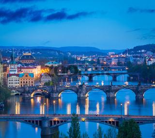 Travel Prague concept background - elevated view of bridges over Vltava river from Letná Park. Prague
