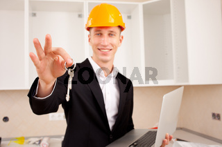 smiling engineer gives keys
