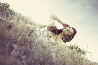 glamour attractive girl in grass
