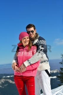 Young Couple In Winter  Snow Scene