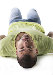 Handsome young man laying on the floor