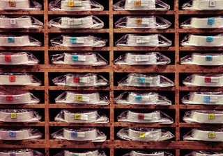 Showcase with many colorful shirts on shelves