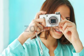 Portrait of a beautiful cute teen girl with digital photo camera