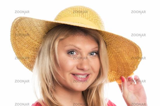 junge blonde frau mit sonnenhut