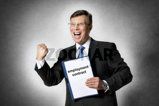 Happy business man with employment contract