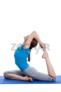 Yoga - young beautiful woman  yoga instructor doing King Pigeon Pose (Raja Kapotasana) exercise
