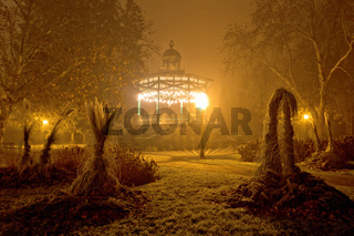 Foggy night view of park pavillion