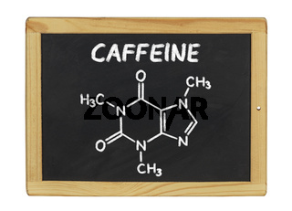 chemical formula of caffeine on a blackboard