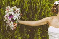 Bride with a Beautiful Bouquet of Flowers