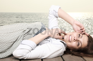 young woman is relaxing on the pier