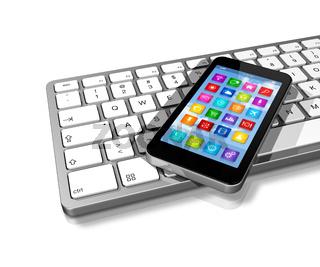 Smartphone on Computer Keyboard