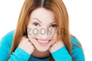 Happy attractive woman sitting