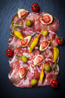 Meat catering platter with olives