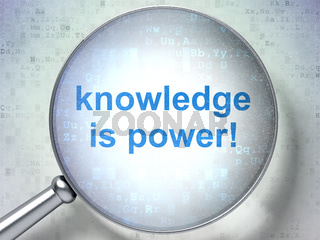 Education concept: Knowledge Is power! with optical glass