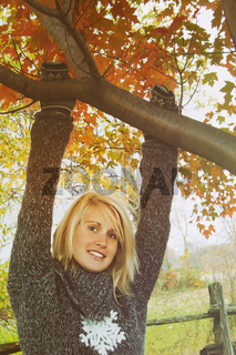 Woman hanging on branch