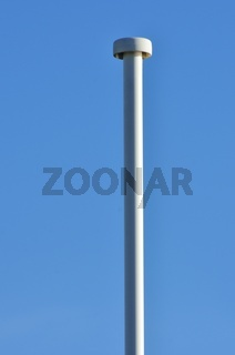 Empty lampost with blue sky