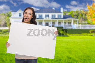 Mixed Race Female with Blank Sign In Front of House