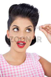 Attractive black hair model using a tweezer