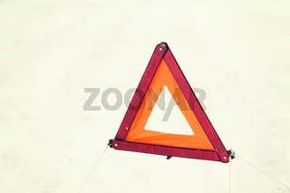 closeup of warning triangle on snow