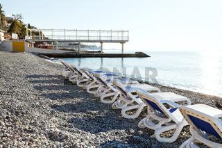 chairs on urban Massandrovskiy pebble beach, Yalta