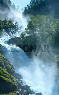 Summer Latefossen waterfall on mountain slope (Norway).