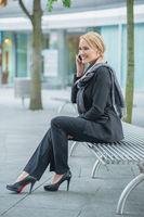 Smiling Businesswoman Talking Through Phone