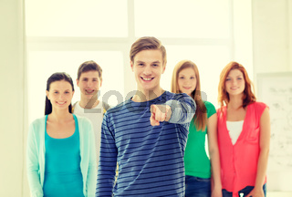 students with teenager in front pointing at you