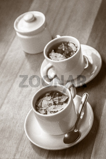 Cups of Coca Tea and Sugar on Wooden Table