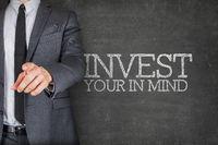 Invest in your mind blackboard with businessman