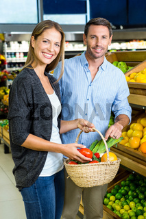 Happy couple doing grocery shopping