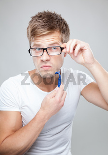 Portrait of a handsome man shaving