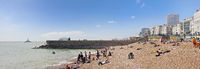 People enjoy a sunny day at the Brighton beach