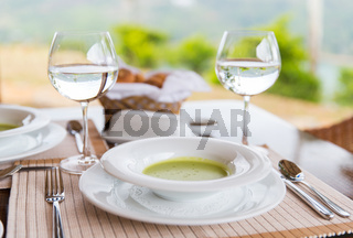 close up of soup and water glasses at restaurant