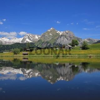 Mt Saentis and Alpstein range mirroring in lake Schwendisee