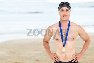 Composite image of victories swimmer posing with gold medal around his neck