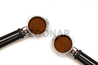 Two italian espresso coffee machine pistons. With ground coffee isolated on white background.