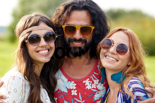 smiling young hippie friends outdoors