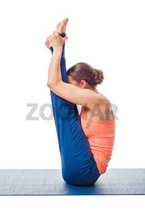 Woman doing Ashtanga Vinyasa yoga asana Urdhva mukha paschimotta