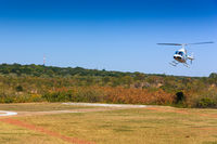Helicopter landing on helipad.