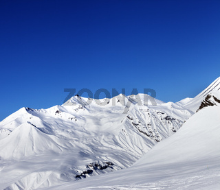 View on ski slope and beautiful mountains at sun day