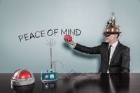 Peace of mind concept with businessman holding brain