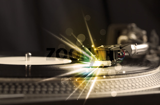 Music player playing vinyl with glow lines comming from the needle