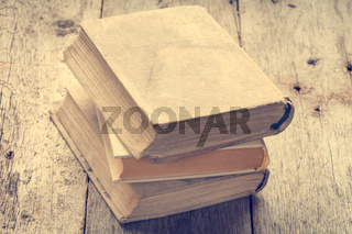 Old books in vintage tone color